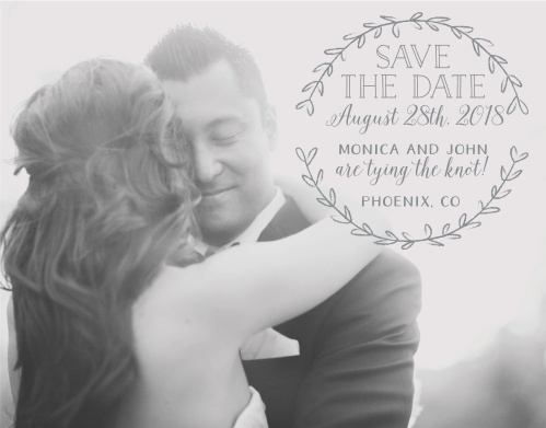 A simple laurel of leaves surrounds your text on the Rustic Love Save-the-Date Cards.