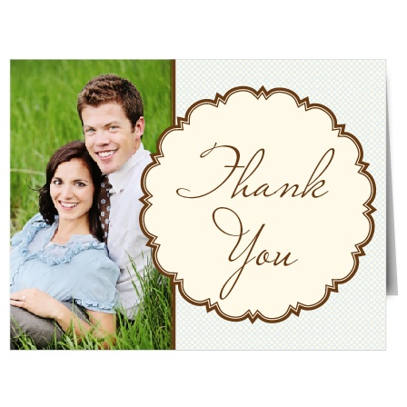 The Scalloped Frame's country chic layout is sure to be remembered for this thank you card. The whole left side of the card is available for you to feature a photo of the happy couple. On the right, a beautifully krafted circular medallion makes your expression of gratitude shine.