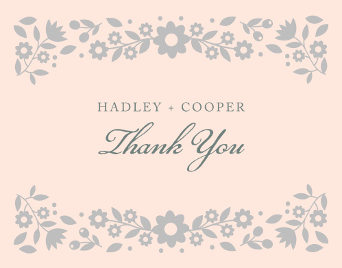 Whimsical flowers decorate the top and the bottom of the Floral Frame Foil Thank You Cards.
