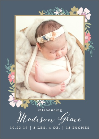 Blossoming bouquets surround a photo of your precious newborn on the Tasteful Tea Party Birth Announcement.