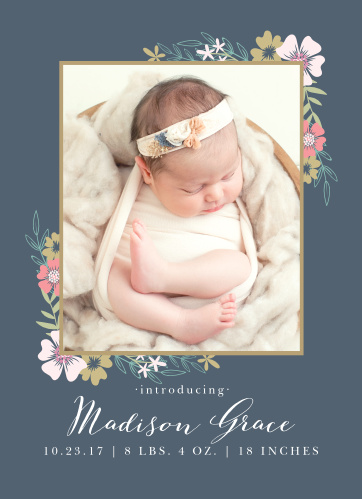 Blossoming bouquets surround a photo of your precious newborn on the Tasteful Tea Pot Birth Announcement.