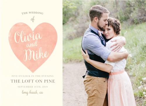 Invite your loved ones to your wedding with cards as beautiful as your day itself: our Simply in Love Wedding Invitations prominently display your favorite engagement photo alongside faded red heart, which bears your names in a cream cursive the same color as the background.