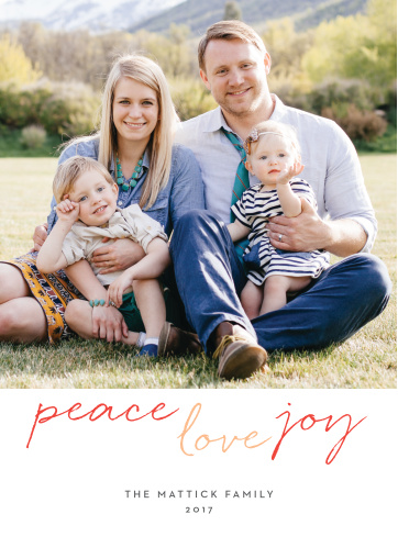 A large photo of your family decorates the majority of our Multi Script Holiday Cards; underneath, in alternating red and peach colors, an elegant script spells out your holiday well-wishes.