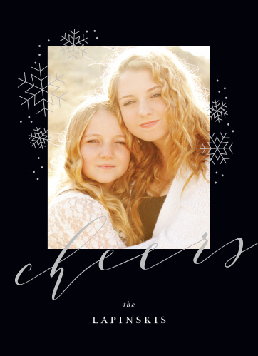 On the rich black background of our Charcoal Chic Foil New Year Cards, adorned with metallic foil snowflakes and typefaces, is a gorgeous photo of your family.