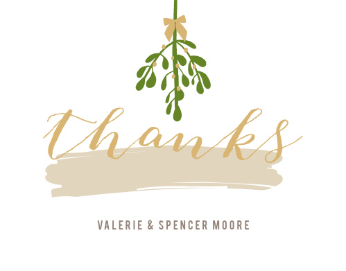 "On our Gallery Holiday Foil Thank You Cards, under a traditional bundle of mistletoe, we've sketched ""thanks"" in a curving script."