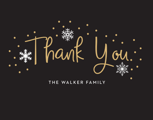 Handwritten Joy Foil Holiday Thank you Cards are reminiscent of a beautiful winter night with a gold-foiled, handwritten font that's set against a rich black background, surrounded by intricate illustrations of snow.