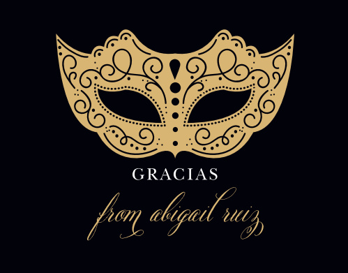 An intricate, gold-foiled mask and decorative calligraphy contrasts with a black background on our Masquerade Mask Foil Thank You Cards.