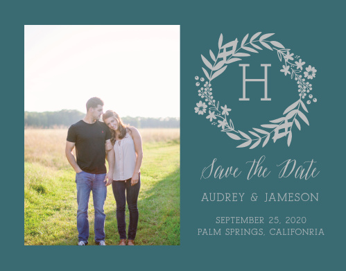 A gorgeous photo of yourselves decorates the left-hand side of our Blooming Monogram Foil Save-the-Date Cards.