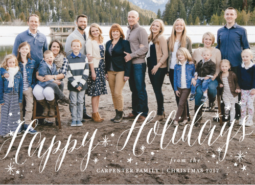 The Sparkler Photo Christmas Cards use your photo as the background and have a cheery, white script adorned with snowflakes.