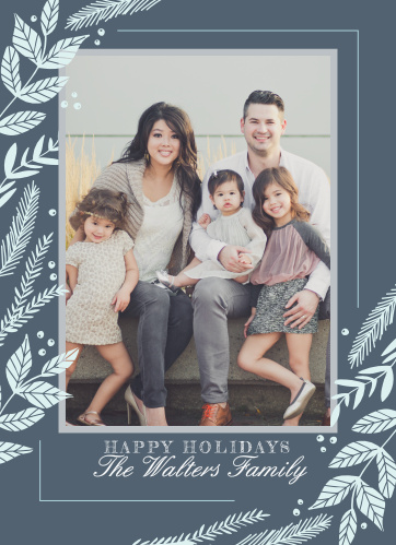 Our Fanciful Foliage Photo Holiday Cards are decorated with ascending columns of festive foliage along the sides, a beautiful family photo in the center, and your holiday greetings at the bottom in alternating bold print and elegant cursive.