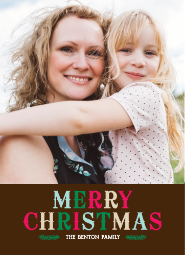A large multi-colored heading in an old fashioned type is the main element of design on the Colorful Christmas Photo Christmas Cards set below your personalized photo.