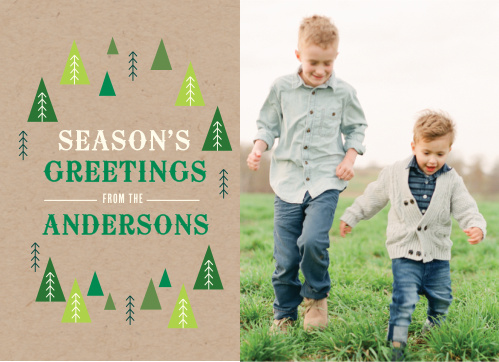 Your seasonal greeting is placed upon a craft paper styled background and framed within multicolored evergreen tree designs next to your portrait.