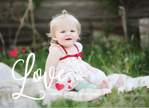 "The Blowing Kisses Valentine's Day Cards use your lovely photo combined with a white, scripted ""love"" and tiny ombre hearts to make the perfect card for this upcoming heart-day!"