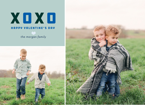 A boxy blue and black XOXO heads the trophy colored text area of the multi-photo Blue Heart Valentine's Day Cards.