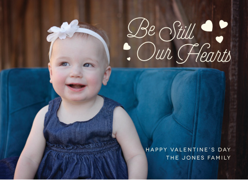 The Our Hearts Valentine's Day Cards use your photo as the backdrop, with a retro script  and tiny hearts decorating the top corner.