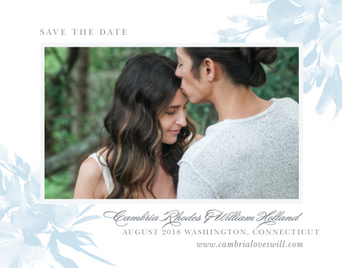 The Subtle Fleuriste Wedding Save-the-Date Cards border your engagement photo with a thick, white frame and soft blue, washed out blooms.