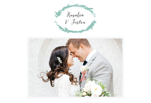 The beautifully simple Leafy Love Website is adorned in a watercolored wreath emblem that holds your names above your lovely engagement photo.