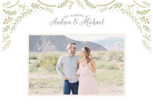 Whimsical greenery descends upon your your names, done up in a curling script, and your lovely engagement photo on the Romantic Evergreen Website.