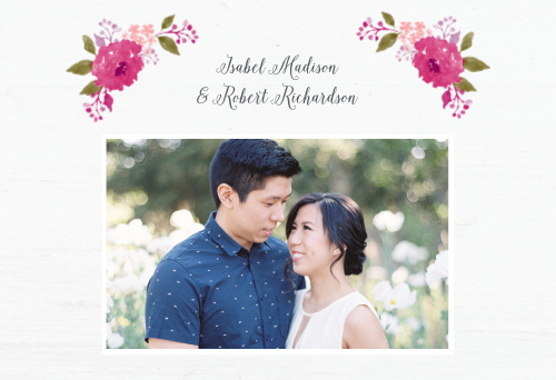 This softly rustic website frames your names in a watercolor-style floral wreath available in your wedding colors.