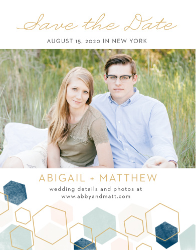 A geometric pattern in pink and blue hues with some gold hexagon outlines graces the bottom of our Geometric Watercolor Save-the-Date Cards.