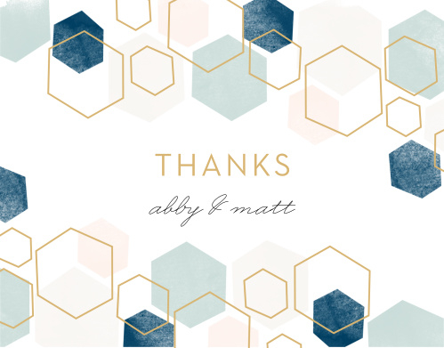 With a geometric pattern in pink and blue hues with some gold hexagon outlines decorating its face, a careful calligraphy sprawling across its center, these cards are a picture-perfect representation of what your guests can expect at your wedding.