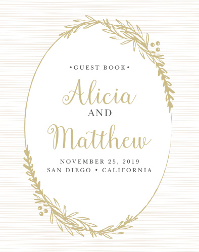 Frame your beautifully scripted names in a rustic gold wreath with the Delicate Laurel Guest Book.
