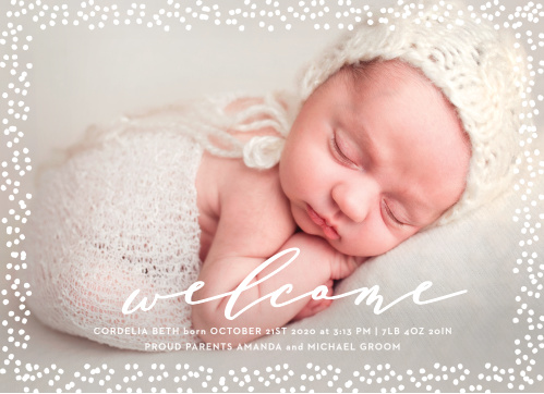 Speckled Dots Birth Announcements place the newest member of your family front and center stage; choose your favorite photo of them to decorate the background of the card, then use the swirling calligraphy and clean print to share all of the details with your friends and family.