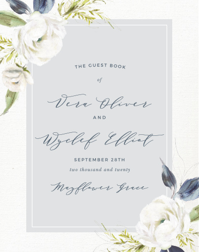 The Oil Paint Textured Guest Book is a vintage marvel, with a canvas background topped with painted blooms and elegant script.