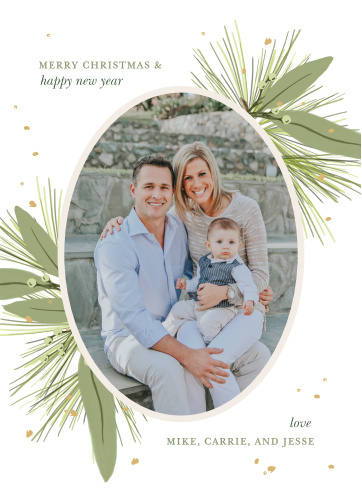 Our Tinsel Wreath Christmas Cards offer a modern take on your classic holiday well-wishes. Your favorite photo adorns the center of the card in an elegant portrait shape, surrounded by tufts of green pine needles and mistletoe. With your Christmas message and family name written in alternating shades of green, these stunning cards are perfect for every single friend and family member.