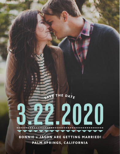 Deco Charm Save-the-Date Cards begin with a photo of the two of you as their foundation, add the date of your wedding in a stunning glass-blue, and then finish with the other details of your wedding in small, sheer white typeface at the bottom.