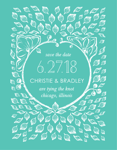 A  white, vintage, leaf adorned crown frames the In the Garden Save-the-Date Magnets along with a deluge of intricate leaves contrasted against a deep aqua background.