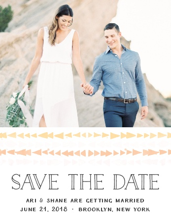 The Brooklyn Loft Save-the-Date Magnets are decorated with graphics of watercolored geometric designs in shades of orange, pink, and yellow set below your engagement photo.