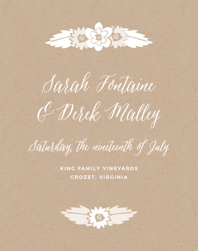 The Rustic Floral Guest Book features charming flower bunches atop a printed kraft background.