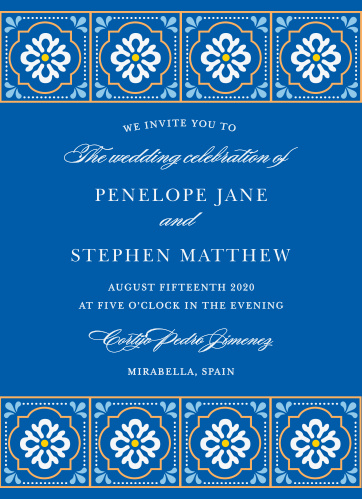 Bright stylized florals make a border at the top and bottom of the Spanish Tile Wedding Invitations.